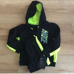 Nike green and black jogging suit.